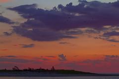 Solstice Sunset (brucetopher) Tags: sunset red rich vibrant colorful sky skies cloud cloudscape landscape orange purple silhouette island marsh saltmarsh sea ocean bay clouds seascape water headland