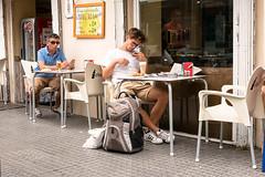 Telefonos movil (Bob Hetherington) Tags: spain españa málaga panasonic lumix dmcgx80 micro 43 50mm out door city life street candid people outdoor walkby