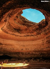 Ancient sea cavern (Mauro Hilário) Tags: cave geology cavern amazing light coast beach sand portugal algarve depth shine sea summer