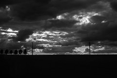 Faltering line (John fae Fife) Tags: france silhouette stormy train landscape xt1 telephonewires trees fujifilmx apompidouday clouds