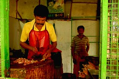 Chicken stall (Rajavelu1) Tags: chickenstall chicken people red green yellow streetphotography colours art creative canon60d india