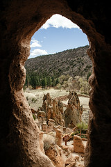 natural windows (almostsummersky) Tags: bandelier path spring hole volcanictuff dwelling cavate rock trees pueblo newmexico ancient tuff travel forest stone trail sky cave bandeliernationalmonument nationalmonument cliff valley losalamos unitedstates us