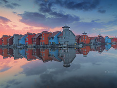 Rainbow Houses (A. Shamandour) Tags: netherlands windmail landscape river sunset sunrise hasselblad sky clouds reflections groningen rainbowhouses architecture