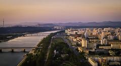 Pink Pyongyang (Baron Reznik) Tags: asia chosun cityscape city view cityview dprk juche juchetower pyongyang northkorea korea rungnadomaydaystadium skyline stadium taedong taedongriver towerofthejucheidea wideangle canon24mmf14lii 평양 주체 조선