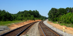 railroad tracks, in daylight (Martin LaBar (going on hiatus)) Tags: southcarolina pickenscounty tracks railroad rails railroadtracks ties railroadties curve curves line lines trees sky track leadinglines
