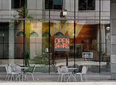 'OPEN 24 HRS.' Selfie (Canadapt) Tags: street window building facade cafe chairs reflection selfie tables lamps sidewalk outdoor toronto canadapt bicycles neon sign people