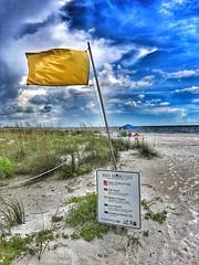 Medium Hazard - Lovers Key (Will-Jensen-2020) Tags: seagrass clouds blue sky hazard medium flag sand statepark beach loverskey florida