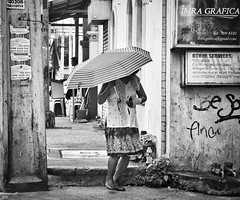 Striped Umbrella (Beegee49) Tags: street lady walking umbrella bacolod city philippines