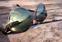 Sunglasses (nicopeña2) Tags: sun sunset summer beach table glasses sunglasses rayban reflection rb wood woodtable day