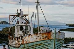 Boat explored (einisson) Tags: boat old wooden stykkishólmur sea mountain rusty iceland outdoor einisson