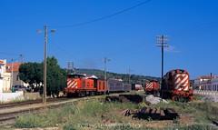Busy times at Tunes junction (rolfstumpf) Tags: portugal caminhosdeferroportugueses tunes trains railway railroad alco passengertrain station locomotive fujichrome brissonneaulotz telegraph rsc2 cp1502