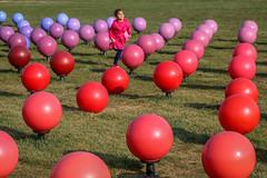 Tehran, Iran (gstads) Tags: iran iranian persia persian tehran azadi azadisquare ball balls color colour colorful colourful girl child female running park geometry geometric