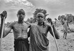Mursi Warriors (Rod Waddington) Tags: africa african afrique afrika äthiopien ethiopia ethiopian ethnic etiopia ethnicity ethiopie etiopian omo omovalley outdoor mursi tribe traditional tribal culture cultural warriors warrior donga stick village huts gun ak47