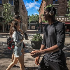 State Street - Headphones (Lisa Richelle Photography) Tags: streetincolor street streetphotography streetcolor squareformat streetlife streetvibe urban madisonstatestreet madison mobilephotography wisconsin people peopleonthemove peopleonthestreets peoplewatch throughawindow city downtown windowshot iphone iphone6 iphonenography color headphones