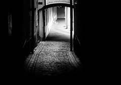 The light at the end... (*Lolly*) Tags: stockholm oldtownstockholm 85mm canon europe sweden bw alley shadows shadow light cobblestones