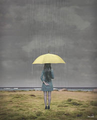Hope For the Best (Lindy Lewan) Tags: rocks grass ocean f28l markii 2470mm 5d canon yellow rain storm sad beautiful darkclouds selfportrait finglescrossed umbrella charlottenc hope depressed imagemanipulation surreal conceptual alone