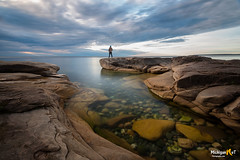 Calm before the Storm (Michigan Nut) Tags: lakesuperior calmwater upperpeninsula longexposure nature person peaceful greatlakes clearwater clouds sky michigan usa coastline water