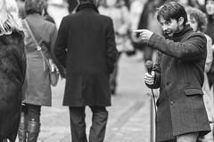 Pointing the finger (Frank Fullard) Tags: frankfullard fullard candid street portrait action finger fingerpointing busker musician galwayirish ireland fun happy monocrome blackandwhite