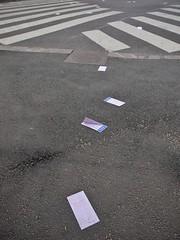 Discarded lottery coupons by a zebra crossing (Kimmo Räisänen) Tags: panasoniclumixgf1 mzuiko14150mm helsinki finland streetphotography composition minimalist minimalism shapes