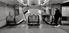 Downhill From Here On (Douguerreotype) Tags: uk gb britain british england london city urban bw blackandwhite mono monochrome people tunnel subway metro tube underground escalator sign