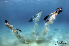 Sand play (bodiver) Tags: hawaii kailua kona wideangle ambientlight fins freediving tokina1017mm sand blue ocean peopleunderwater mermaid