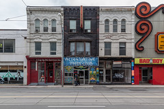 Bathurst Street (Gary Kinsman) Tags: bathurststreet toronto canon24105mmf4l canada ontario canoneos5dmarkii canon5dmkii overcast grey clouds architecture topographics newtopographics 2017 urbanlandscape mirvishvillage store shop sign victorian shops shopfront abandoned derelict redevelopment gentrification space alternativethinking aleguppetservicesinc vintagegrounds badboy urban