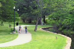 Passersby (DaveLawler) Tags: passerby passersby park elmpark worcester massachusetts newengland green grass pond goose bicycles girls trees nikon nikkor