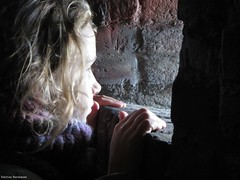 Looking through (katrienberckmoes) Tags: girl looking through stone window tunnel fortress wall veere old harbour city zeeland holland places visit mysterious atmosphere special light portrait