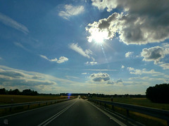 sunny road perspective (Ola 竜) Tags: sky skyscape road highway way lawn grass green blue white clouds sun sunny day ride drive landscape asphalt sunlight sunshine flare sunrays rays beams horizon car