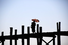 (cherco) Tags: myanmar umbrella composicion composition canon colour red rojo bridge puente wood monk monje walk walker lonely solitary solitario sky cielo loner alone silhouette shadow silueta sombra 5d