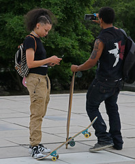 """Power Couple"" - Street Portrait - Downtown Chicago - 08 Jun 2017 - 80D - 210 (Andre's Street Photography) Tags: chicago08jun201780d tattooed tattoos pierced bodypiercings man woman couple powercouple colorful skateboards skateboarders chicago millenniumpark downtown loop innercity chitown chicagoland illinois us vs usa chicagostreets chicagoist chicagoistphotos chicagotribune chicagojournal chicagomagazine photobyandrevanvegten midwest outdoor art artistic dusk street straat straatfotografie straatportret streetportrait streetphotography fotografiadistrada strasse strada lacalle larue selfie selfportrait dedicatedtodianearbus tributetoedvanderelsken robertfranksworld dutchstreetphotographers chicagostreetphotographer candid streetlife urbanlife urban lifestyle counterculture ontheedge edgy canon eos 80d outthere cellphone cellphonecamera digital online persona cyberspace socialmedia"