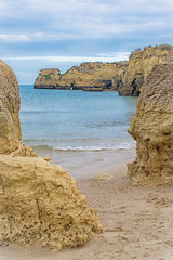 A beach, a beach, my wages for a beach... (JDWCurtis) Tags: beach sea seafront seaside seascape ocean waves rock rocks cliffs blue yellow algarve portugal paradise relaxation relaxing peace