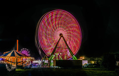 the big red dot (pbo31) Tags: bayarea california color july 2017 summer boury pbo31 night dark black fair spinninglight lightstream motion ride midway carnival traveling eastbay alamedacounty oakland ferriswheel red spin 880 nikon d810
