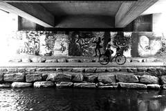 Under the bridge (Leica M6) (stefankamert) Tags: stefankamert street bridge under leica m6 leicam6 rangefinder summitar film analog grain bicycle woman ilford fp4 blackandwhite blackwhite monochrome noir noiretblanc