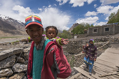 Hi (Ravikanth K) Tags: 500px kid people outdoor key village ki spiti valley mountains remote daylight trans himalayas himachal pradesh villagers colourful red casual attire baby waving india highaltitude bridge houses clouds