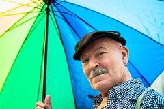 Avoiding The Sun (Sean Batten) Tags: london england unitedkingdom gb pride lgbt nikon d800 58mm umbrella person streetphotography street green blue yellow hat city urban parade portrait