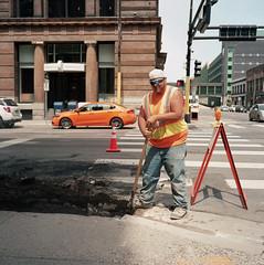workman-orange (kaumpphoto) Tags: construction orange workman car pavement dig rolleiflex street city urban tlr