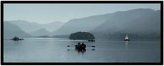 Rowing Boat (Develew) Tags: boats rowingboat sailingboat mist lake lakedistrict hills hillside island oars sails calmwater water