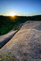 Sunset Splitter (scottymanphoto) Tags: horizon rock natural landscape artistic overlook nature treetops summit bushes tranquility trees vista starburst solarflares outside sunspots highlands scenic crack sky split america top heavens ledge view redrivergorge spring cavern cloudsplitter sunset shade danielboonenationalforest rocky resting vignette outdoors rocks vignetting boulders hikers bluesky shadow tranquil country frenchburg beautiful high forest hiking greenery adventure clouds usa kentucky cliff mountain