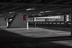 E F (pi3rreo) Tags: noisy colors fujifilm fujinon noiretblanc black white shadows ombres parking city ville paris france ile lumière light rouge red pilier urbain urban xe2