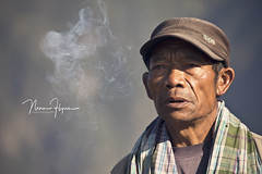 Puff the puzzle (ninaflynnphotography) Tags: people smoke canon man candid indonesian photography personalitity origin tengger eastjava ethnicity capture lighting morning ninaflynnphotography ninaflynn2017 bromo travel culture canonef70300mmf456lisusm