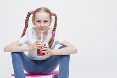 Kids Concepts. Little Caucasian Blond Girl Posing with Pink Pennyboard and Drinking Red Juice from Long Cup Using Straw. Against White. (DmitryMorgan) Tags: 1 710years adorable baby beautiful blond caucasian cheerful child childhood cup daughter drinking expression fashion female fun girl happiness holding human joy joyful kid liquid little love model mood one only pennyboard pigtails pink portrait positive preschooler school schoolgirl skateborad small smile sneakers straw streetfashion studio whitebackground young