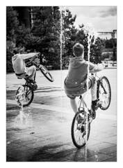 BMX Bandits (Dave Fieldhouse Photography) Tags: birmingham city citycentre town bikes kids youths fountain wheelie bmx summer sunshine water street streetphotography project wwwdavefieldhousephotographycom fuji fujifilm fujinon35mmf2 candid