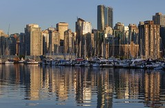 From The Marina To The Hi-Rise (Clayton Perry Photoworks) Tags: vancouver bc canada spring explorebc explorecanada skyline stanleypark coalharbour buildings boats reflections