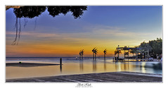 Cairns Esplanade Lagoon (Brett Huch Photography) Tags: australia aussie queensland qld cairns cairnsharbour cairnsesplanade cairnspool cairnslagoon lagoon pool publicpool swimmingpool seascape seascapes sea sky sunrise reflection reflections water trees tree