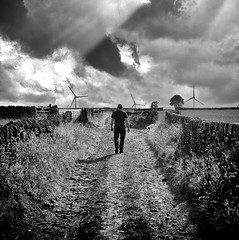 Walk Alone (Missy Jussy) Tags: man windfarm sky sunlight clouds darkclouds yorkshire england path countryside trevorkerr walls drystonewalls fields horizon outdoor outside mono monochrome blackwhite bw blackandwhite canon canon5dmarkll 50mm ef50mmf18ll canon50mm fantastic50mm
