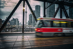 Streetcar Views (Paul Flynn (Toronto)) Tags: toronto streetcar tracks city downtown transit commission wet cntower rocket bathurst bridge street
