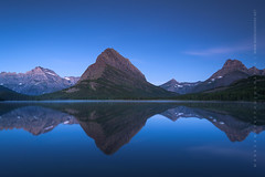 Swiftcurrent Glacier National Park Blue Hour (Mark VanDyke Photography) Tags: morning bluehour reflections montana mt glaciernationalpark gnp westernusa calm reflecting rockymountains outdoors outside landscape outdoorphotography