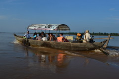 Boat on the Mekong (Romane Licour) Tags: boat wood local cambodianpeople people localpeople landscape water river mekong mekongriver tourists