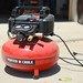 red Porter Cable air compressor in driveway